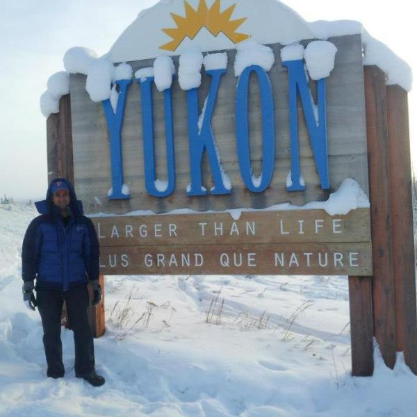 Adam Pinsker at the Yukon border, during a drive through Alaska. The Yukon is a Canadian territory that borders Alaska.